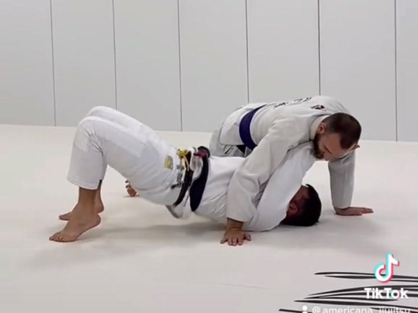 side control escape into an armbar